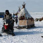 На праздник оленеводы добираются вертолетом, на оленях или на снегоходах
