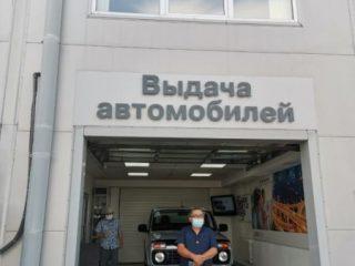 Один из счастливых обладателей призовой машины - Сергей Чумаченко