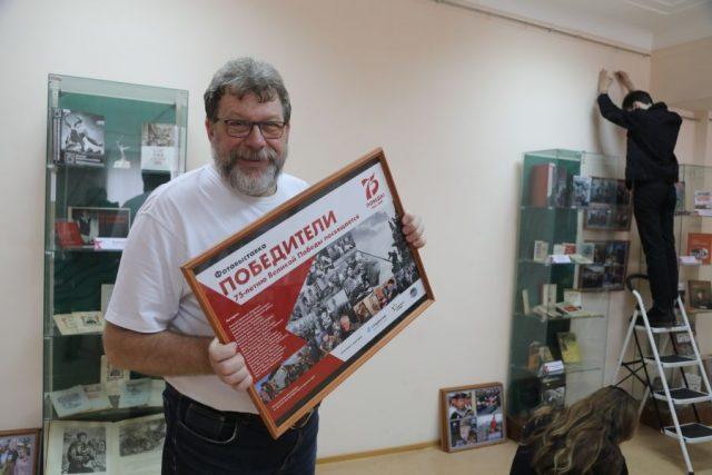 В краевой научной библиотеке открылась фотовыставка «Победители». Красноярск. 6 апреля